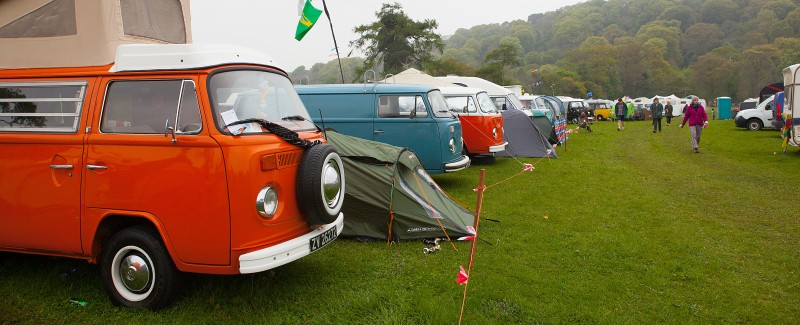 image of campervans and festival people having fun